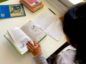 After 6 months of learning English a student has decided to translate sections of her favourite book into Japanese. Given the time & space, she makes sense of her new language through the lens of her home language.